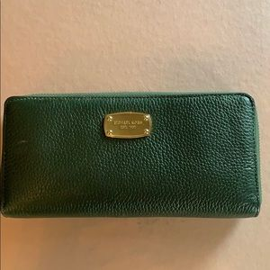 Like new Michael Kors green wallet